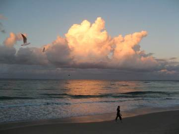 Walking along Burleigh Beach at sunset.