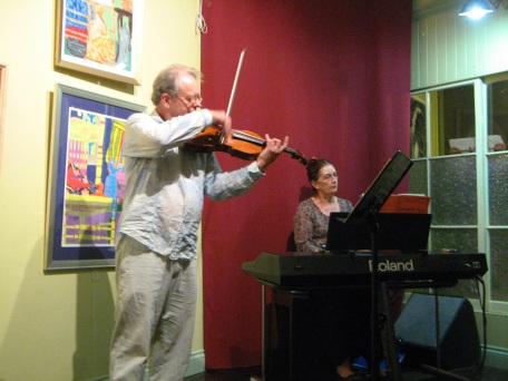 Jim Durack and Anne playing a Mozart duet.