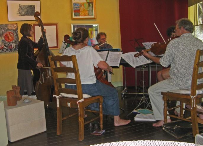Barefoot folk orchestra rehearsing.