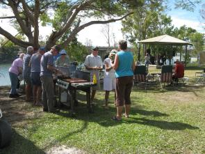 The happy campers line up for their free sausages
