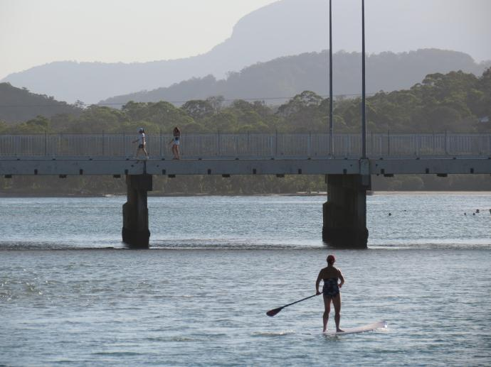Paddle boarder enjoys the calm water