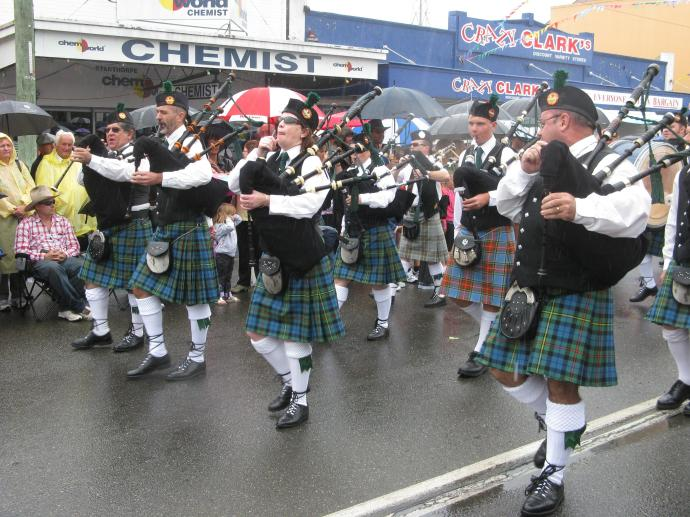 Striding manfully forward pipes playing, kilts swirling...