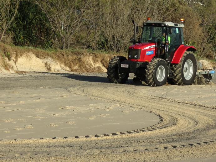 Tractor grooming the beach