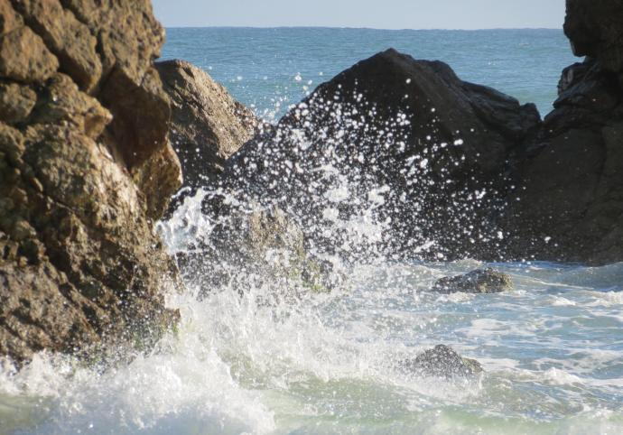 Breaking waves and spray