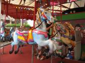 You can even have a ride on a wooden carousel horse.
