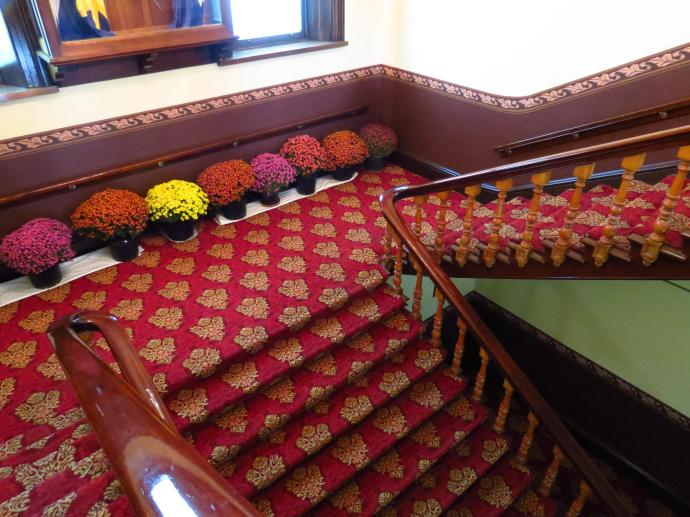 Pots of chrysanthemums decorate the stair well