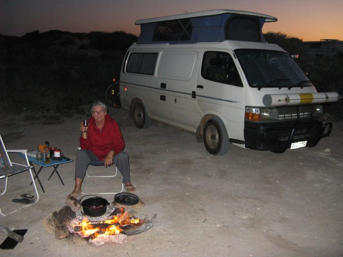 Cooking over an open fire and eating under the stars