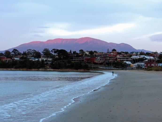 The sun catches the peak of Mount Wellington