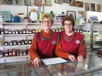 Friendly volunteer staff in the CWA shop