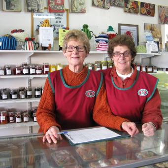 Friendly volunteer staff in the CWA shop