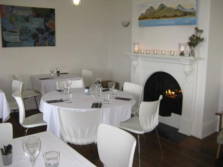 The inside rooms of the restaurant have a cosy fire glowing, but the view is better from the veranda tables