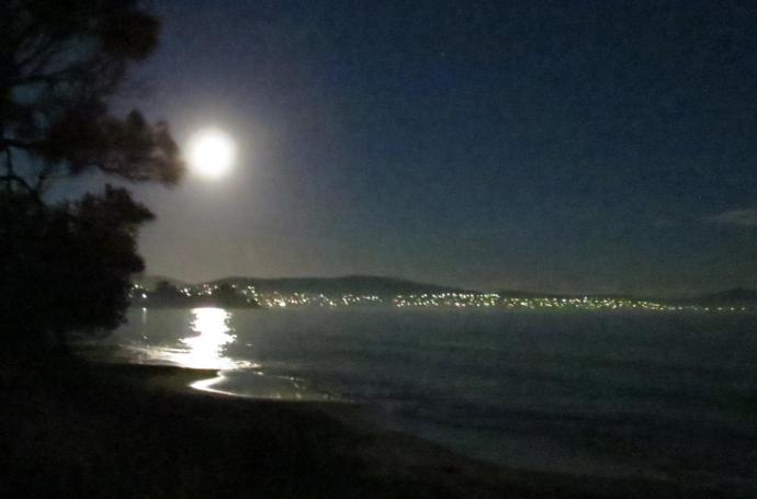 Super moon reflections, with the lights of Hobart in the back ground.