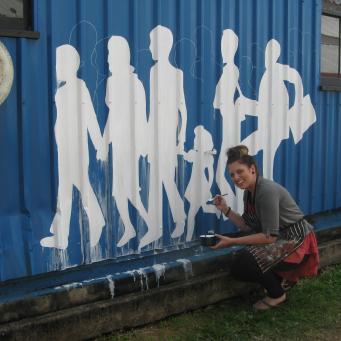 Jo-Ellen Bouttell working on the mural, a work in progress