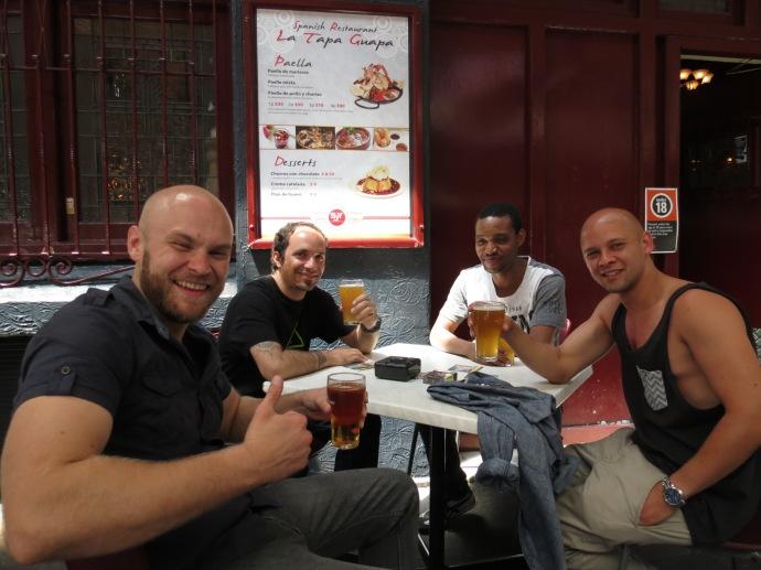 4 mates enjoying a drink together