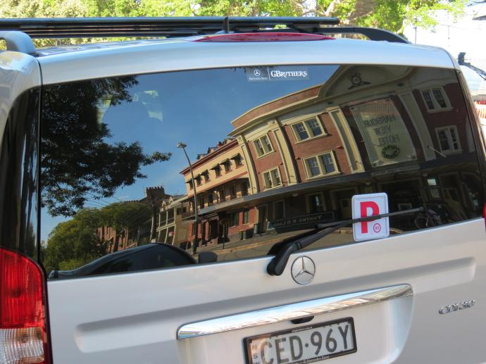 Reflections in the back window of a car of a hotel in the Rocks area