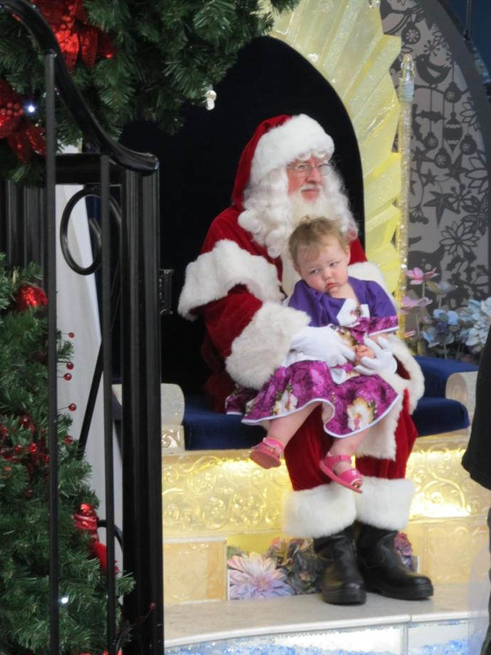 I don't think this baby really knows what Christmas is all about yet...