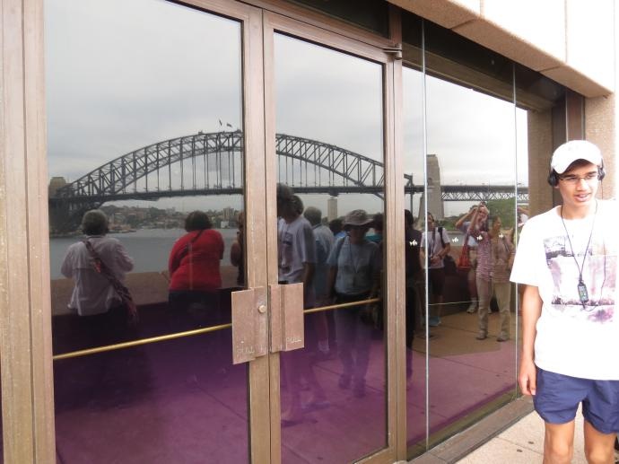 Sydney Harbour Bridge reflected in the windows of the Opera House