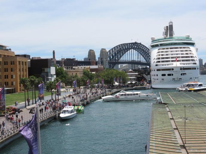 The cruise ship dwarfs the bridge.