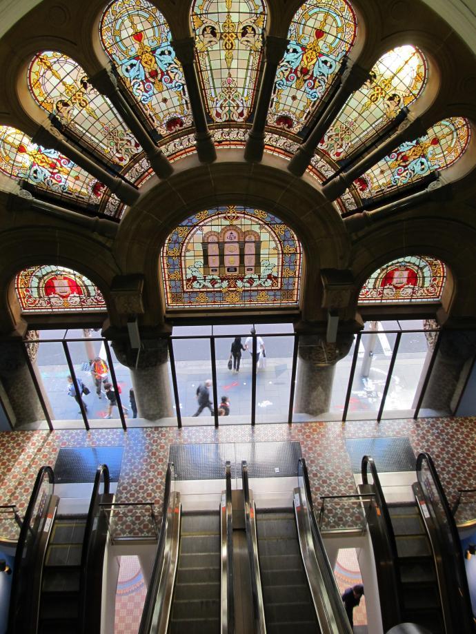 Beautiful stained glass windows illuminate the stairwell between floors