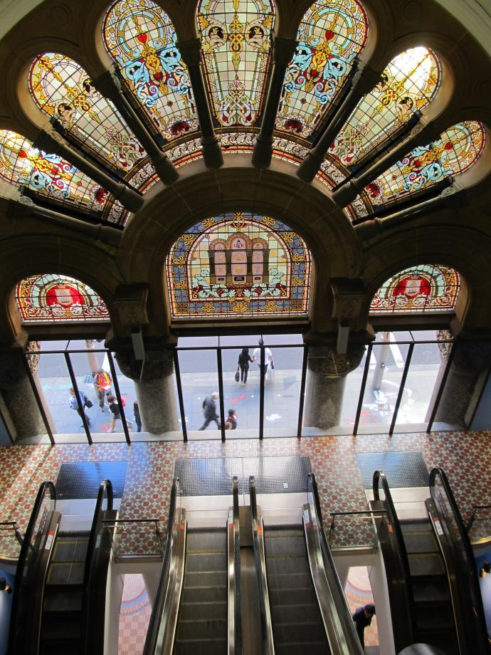 Beautiful stained glass windows illuminate the stairwell between floors