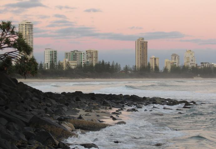 The soft pink and grey of the pre-dawn highlights the buildings of the Goldcoast