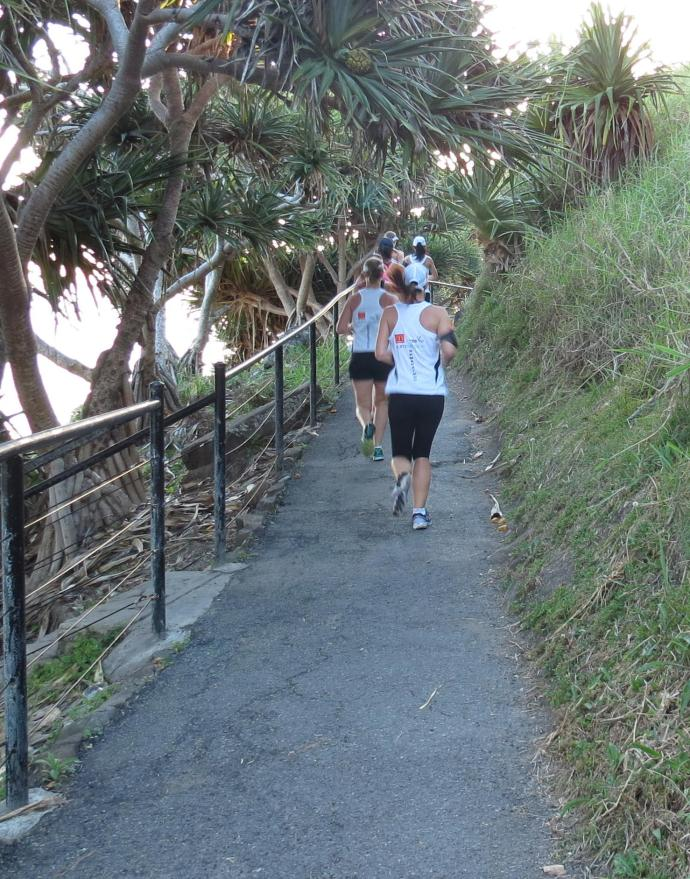 Joggers exercise early to beat the heat of the day