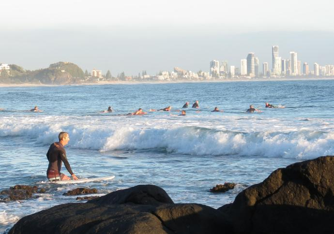 Keen surfers arrive early to catch a wave or two