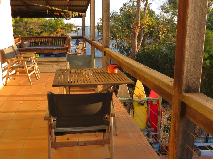 Looking out to the west the setting sun lights the deck in a golden glow