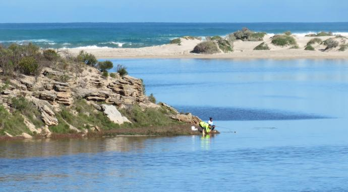 At the river mouth of the Greenough River a couple of fishermen try their luck
