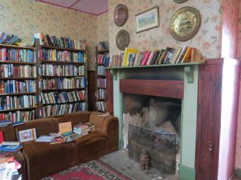 This would be a lovely cosy place to sit near the fire to browse through the books