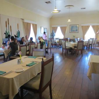A group had decided to eat in the dining room that was originally the ballroom