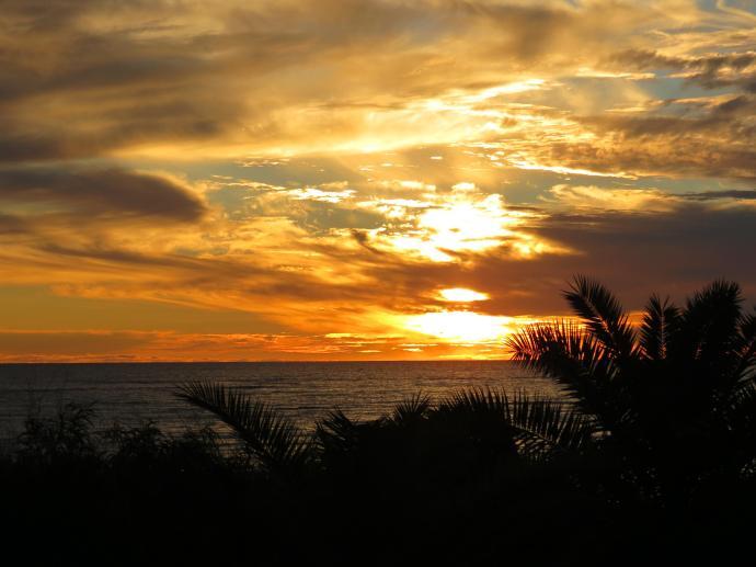 The sun slowly sinks toward the horizon