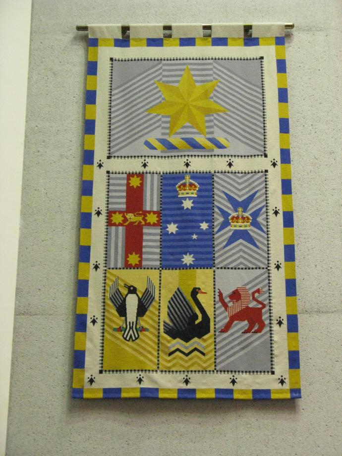 Tapestry of the emblems of the States on the wall in the main court room