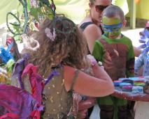 a fairy is face painting