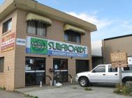 Near the beach surf board shops are every where.