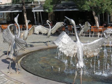 Joyful sculpture of dancing Brolgas