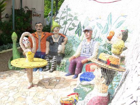 A mosaic family watch a ballerina spinning