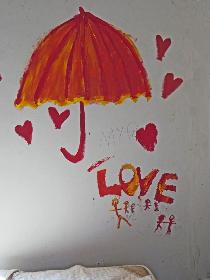 The children decorate the walls with love.